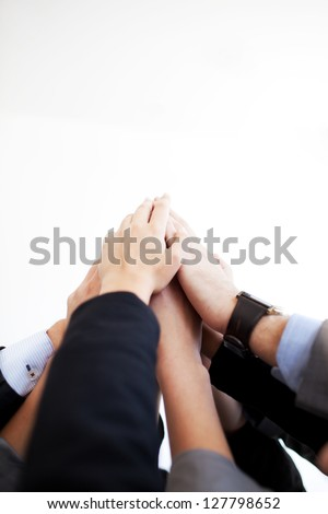 Group of business people joining hands together isolated. - stock photo