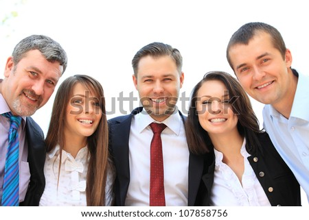 Group of business people laughing and smiling - stock photo