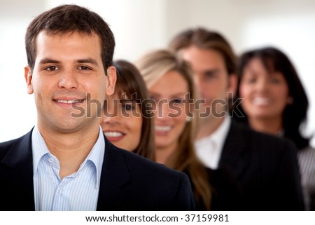 Group of business people lined up in an office - stock photo