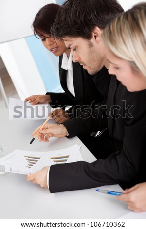 Group of business people looking at charts in the meeting - stock photo
