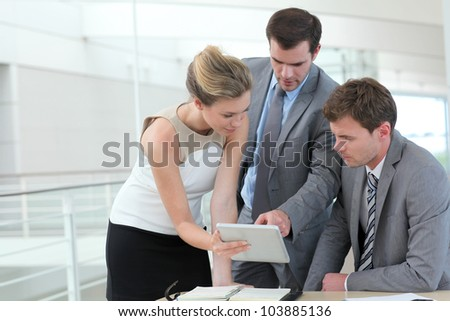Group of business people meeting around table - stock photo