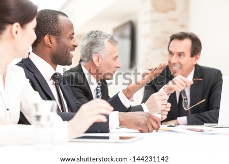 Group of business people meeting at table - stock photo