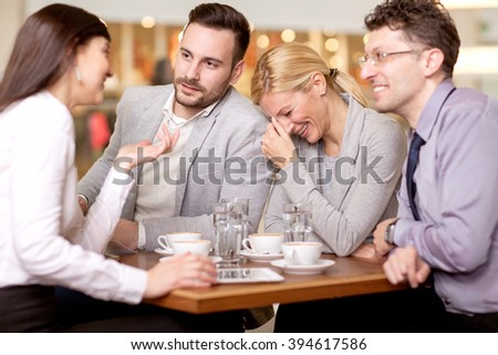 Group of business people  meeting in coffee shop - stock photo
