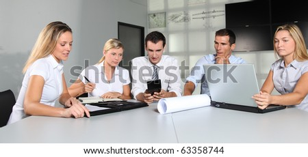 Group of business people meeting in the office - stock photo