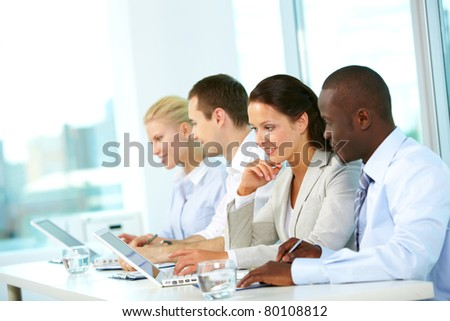 Group of business people planning work in office - stock photo