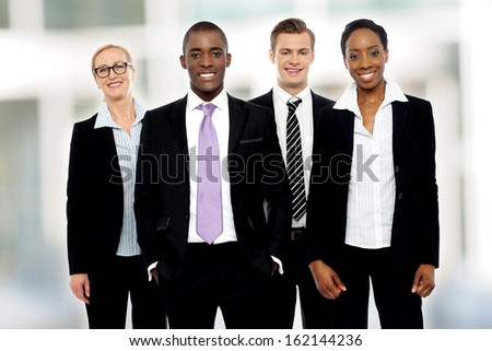 Group of business people posing together