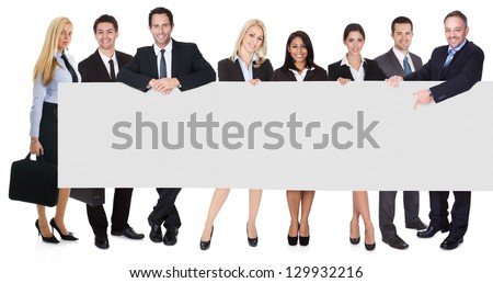 Group of business people presenting empty banner. Isolated on white