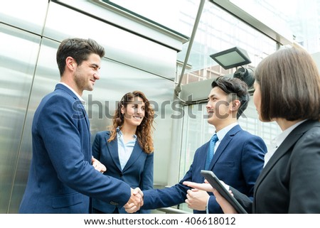 Group of business people shaking hand - stock photo