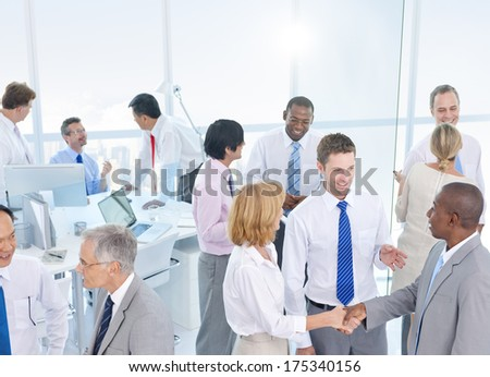 Group of Business People Shaking Hands in an Office - stock photo