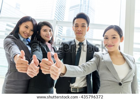 Group of business people showing thumb up together - stock photo