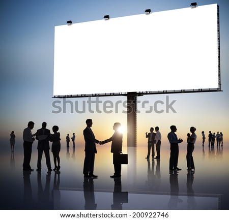Group Of Business People Silhouettes Outdoors And An Empty Billboard Above