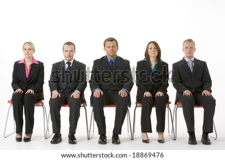 Group Of Business People Sitting In A Line - stock photo
