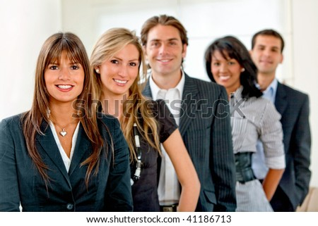 Group of business people smiling at the office - stock photo