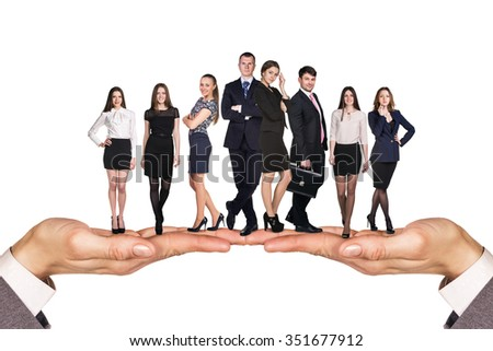 Group of business people stand on human hands over white background - stock photo