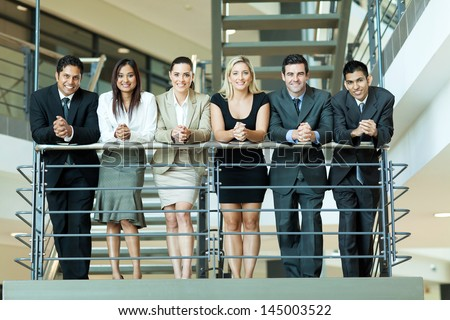 group of business people standing by stairway - stock photo