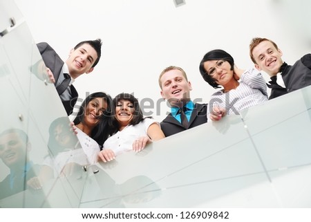 Group of business people standing in office - stock photo
