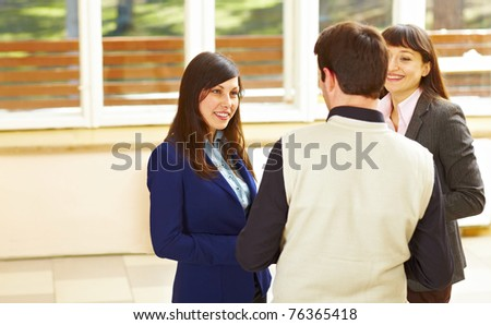 Group of business people standing in office and discussion something - stock photo