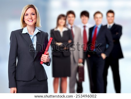 Group of business people team over office center background. - stock photo