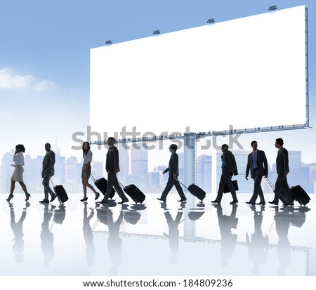 Group of business people travelling with placard.