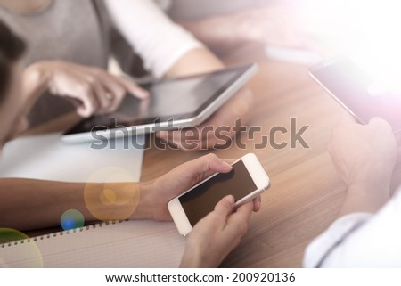 Group of business people using electronic devices at work - stock photo