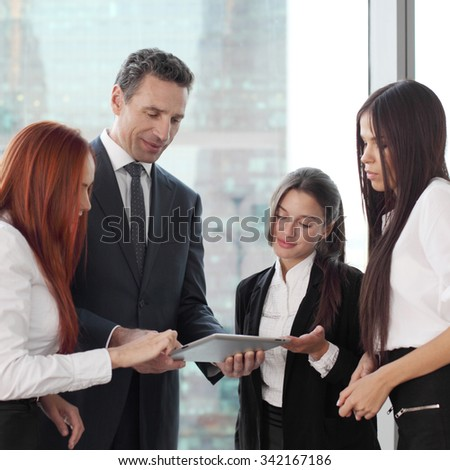 Group of business people using tablet in office