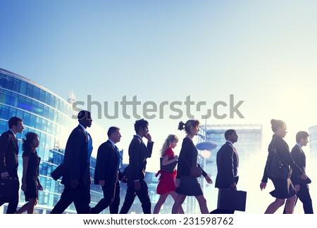 Group of Business People Walking Back Lit Concept - stock photo