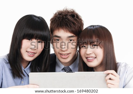 Group of business people with a laptop  - stock photo