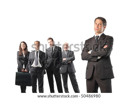 Group of business people with close up to a serious businessman - stock photo