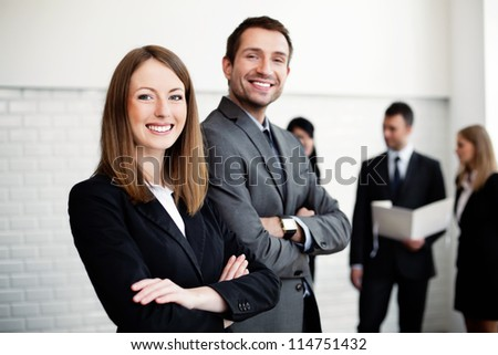 Group of business people  with female leader in foreground - stock photo