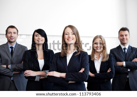 Group of business people with female leader on foreground - stock photo
