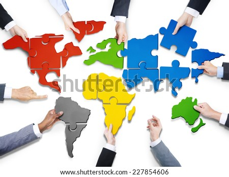 Group of Business People with Jigsaw Puzzle Forming in World Map - stock photo