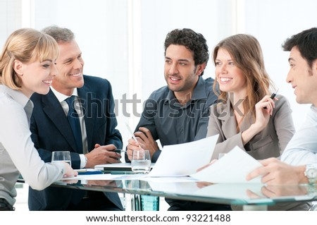 Group of business people working and discussing together at office - stock photo