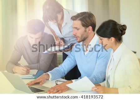 Group of business people working on laptop