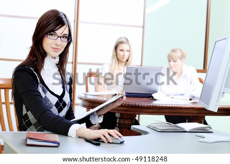 Group of business women interacting together at the office. - stock photo