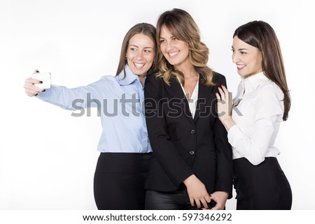 Group of business women taking selfie together