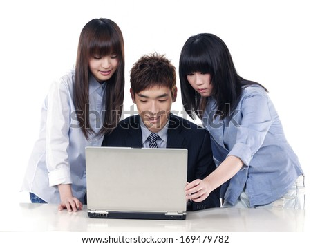 Group of business working together on a laptop - stock photo
