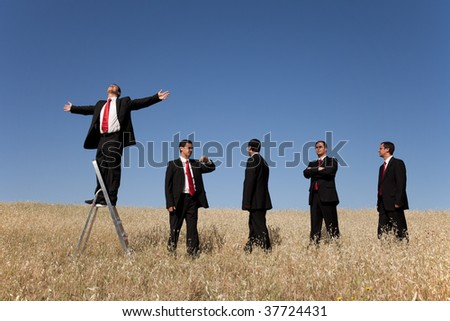 group of businessman in line waiting for there time to be successful