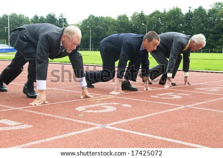 Group of businessmen are ready for the start of the run. - stock photo
