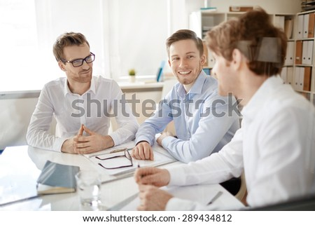Group of businessmen discussing plans in office - stock photo