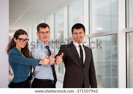 group of businessmen in the office to express their joy