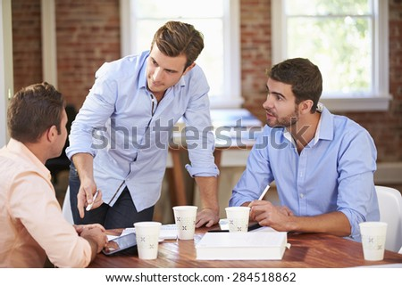 Group Of Businessmen Meeting To Discuss Ideas