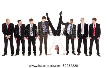 Group of businessmen with on upside down