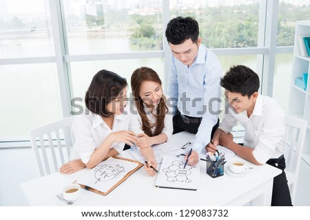 Group of businesspeople brainstorming at office - stock photo