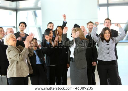 Group of businesspeople cheering - stock photo
