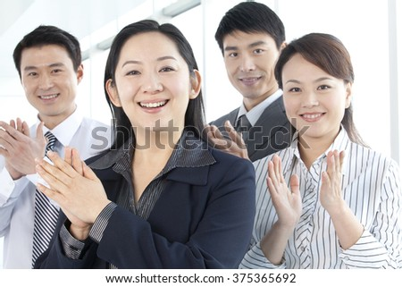 Group of Businesspeople Clapping