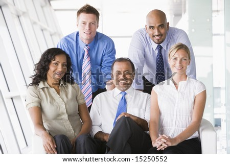 Group of businesspeople in office lobby - stock photo