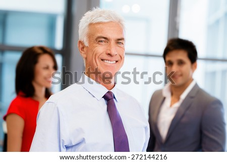 Group of businesspeople in office standing