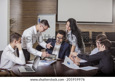 group of businesspeople interacting at meeting  - stock photo