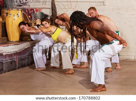 Group of capoeira students with master teacher - stock photo