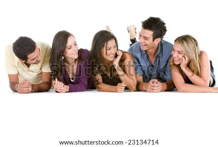Group of casual people lying on the floor isolated over a white background